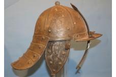A Mid 17th Century Lobster Tailed Helmet