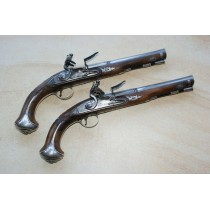 A Fine Pair of Flintlock holster pistols by G Wallis of Hull.
