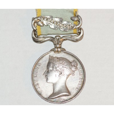 Crimea Medal with ' Sebastapol ' Clasp,Engraved to George Webb H.M.S. Terrible.