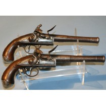 A Good Pair of Early 18th Century Silver Mounted Queen Anne Flintlock Pistols by J Johnson of Wigan